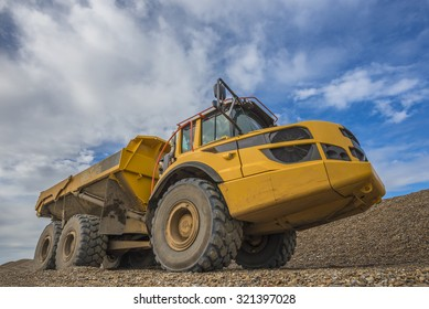 Six wheeled tipper truck on a stony background