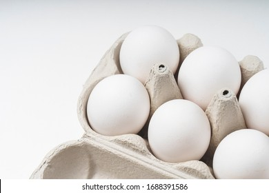 six white chicken eggs, top view, selective focus tinted image