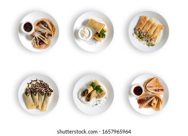 six white plates with different types of pancakes on a white background. top view.