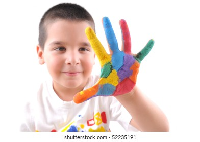 Six year old boy with hands painted in colorful paints makes a big five