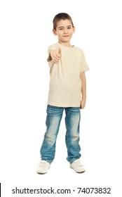 Six years  age boy in blank beige t-shirt giving thumb up isolated on white background