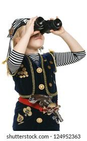 Six years girl wearing costume of pirate looking away through the binoculars, over white background