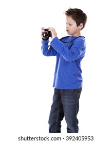 six years old boy taking photos with his camera on white background