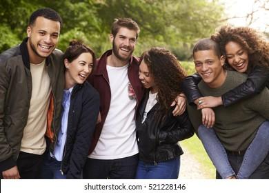 Six young adult friends having fun on a country walk