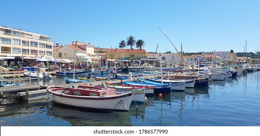 Six-Fours-les-Plages, France - 25 July, 2020: People walking in the Brusc port. The marina is naturally protected from the wind by the Embiez island.
