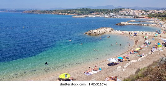 Six-Fours-les-Plages, France - 26 July, 2020: People enjoying the summer in the Coudouliere beach. The area is famous for its landscapes and spots to practice windsurfing  and diving.
