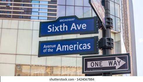 Sixfth ave Broadway street sign, Manhattan New York downtown. Blue signs on blur buildings facade background, Avenue of the Americas