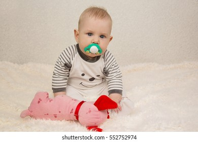 six-month boy boy playing with a toy on a light background