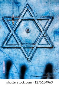 A six-sided Star Of David is a decorative element on a garage door in Jerusalem, Israel.