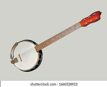 six-stringed banjo on a gray background.