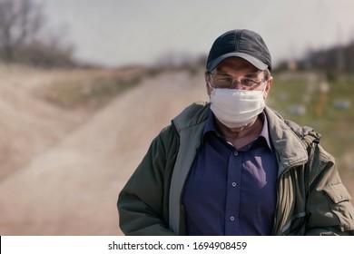 Sixty year old man in quarantine medical mask