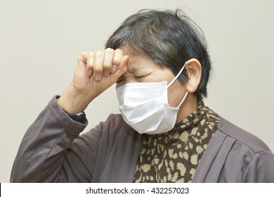 Sixty years old woman ; Fever, Sick, Headache