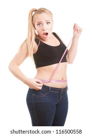 Size 40 girl is shocked by measuring her waist, diet and overweight concept