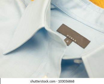 A size and brand tag on a finest-quality shirt - close up