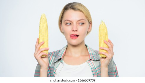 size concept. healthy teeth. Farming, farmer girl with maize. corn crop. vitamin and dieting food. agriculture and cultivation. Happy woman eating corn. vegetable harvest. handjob or blowjob concept.