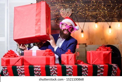Size matters. Man santa claus hat carry big gift box. Biggest gift for christmas. Celebrate christmas with giant gifts. Big wrapped box with ribbon. Great surprise. Prepare huge surprise gift.