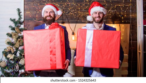 Size matters. Men santa carry big gift boxes. Biggest gift for christmas. Big wrapped box with ribbon. Great surprise. Prepare huge surprise gift. Men compete who has larger size. Bigger gift battle.