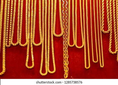 Sizing Length of Thai gold jewelry shop display many gold necklace design pattern ( 96.5% ) on red carpet screen