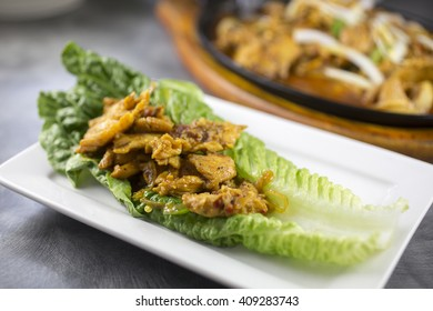 Sizzlin lemongrass chicken with jalapenos, turmeric and lettuce wraps