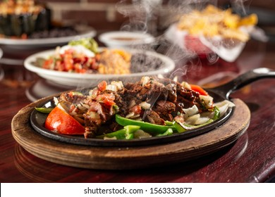 sizzling beef fajita platter in skillet