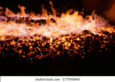 Sizzling peat fire in a distillery