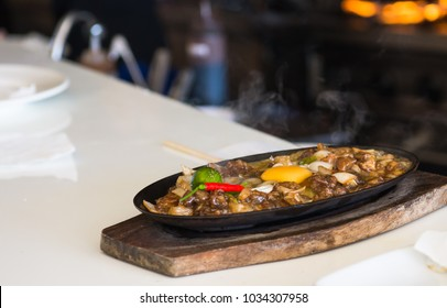 sizzling pork sisig with raw egg