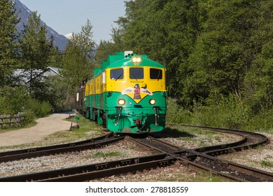 SKAGWAY, AK, USA-MAY 16: One of the 90 series engines of the White Pass and Yukon Railroad pulls the train on May 16, 2015. These attractive diesel locomotives were built in the early 1960s.