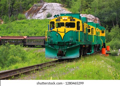 SKAGWAY, ALASKA : 17 JULY 2009 : The green and yellow livery of the famous locomotive travelling along the White Pass route on the Yukon railroad between Skagway, Alaska and Whitehorse, Yukon