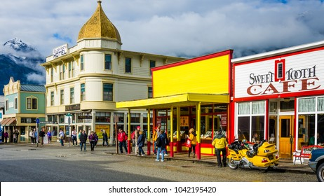 SKAGWAY, ALASKA - SEPTEMBER 10, 2016: Colorful storefronts line the street in a town that attracted hundreds of prospectors arriving every day by steamer from Seattle during the Klondike Gold Rush.