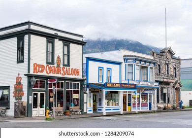 Skagway, Alaska - September 28, 2017: Red Onion Saloon (a restaurant, bar and brothel museum), Camp Skagway No.1 (an Arctic Brotherhood building), and jewellery stores between, in downtown Skagway
