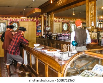 Skagway, Alaska, United States - August 7, 2009: The Mascot Saloon, an authentic restoration of the ancient Skagway. People statues made in wax.