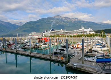 SKAGWAY, ALASKA, USA - JULY 25, 2018 - View of harbour at Skagway on Pacific West Coast with mountain backdrop, Yukon, Alaska, USA