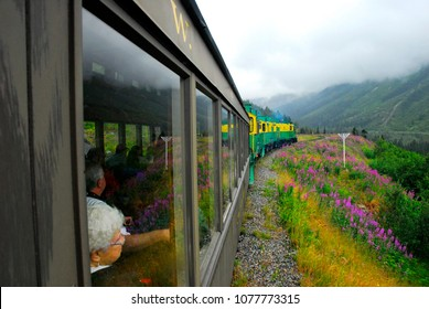 Skagway, Alaska / USA - July 26, 2011: Riding the White Pass Railway from Skagway to the Yukon Territory.