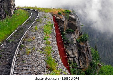 Skagway, Alaska / USA - July 26, 2011: A precarious high section of the White Pass Railroad up above Skagway.