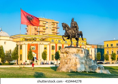 Skanderbeg square with flag, Skanderbeg monument and The Et'hem Bey Mosque in the center of Tirana city, Albania.