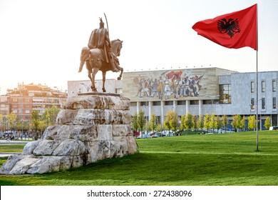 Skanderbeg square with flag, Skanderbeg monument and national museum in the center of Tirana city, Albania.