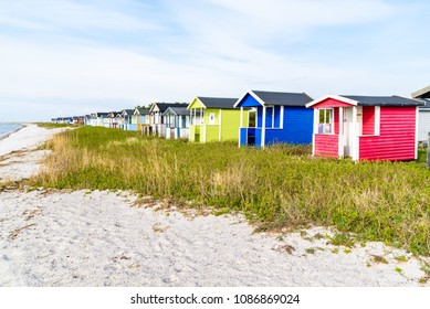 Skanor, Sweden - Long row of colorful bathing sheds along the sandy beach