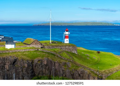 Skansin fortress of Torshavn and its lighthouse in Faroese island of Streymoy. Atlantic Ocean and Nolsoy island are at background