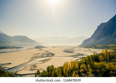 Skardu landform shows desert with Indus river and mountains in the background. Gilgit Baltistan, Pakistan.