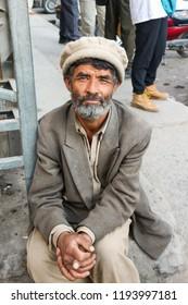 SKARDU, PAKISTAN - JULY 28 : An unidentified old man poses for a portrait as he rests after hard work July 28, 2018 in Skardu, Pakistan