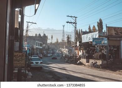 Skardu, Pakistan. October 12, 2015 :  Buildings and vehicles along the street in the city of Skardu, Gilgit Baltistan.
