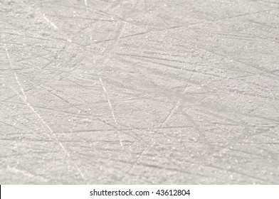 Skate marks on the ice surface of an ice rink