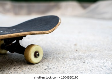 Skateboard close up on a skate park background