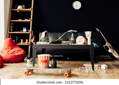 skateboard with food and drinks in messy living room