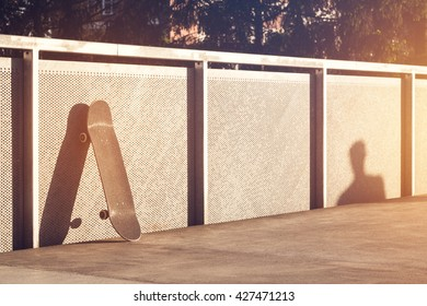 Skateboard leaning against wall. Skateboard in the modern space. Skateboard with copy space.