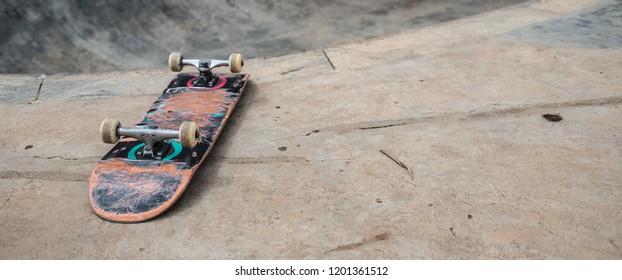 Skateboard on the ground in a skatepark