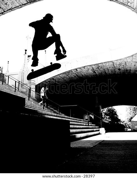 Skateboard silhouette doing a kickflip
