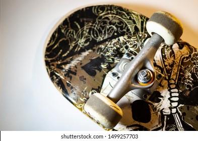 Skateboard wheels and trucks up close.