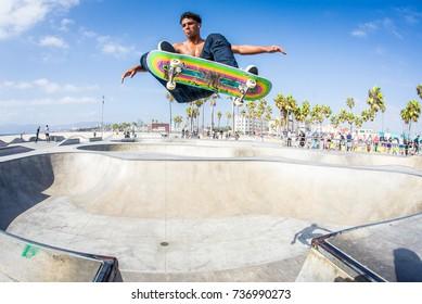 Skateboarder catches air at Venice Skatepark in Venice California