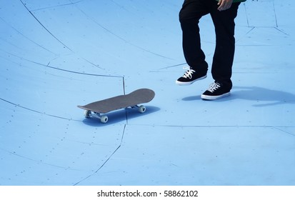 Skateboarder collecting his board